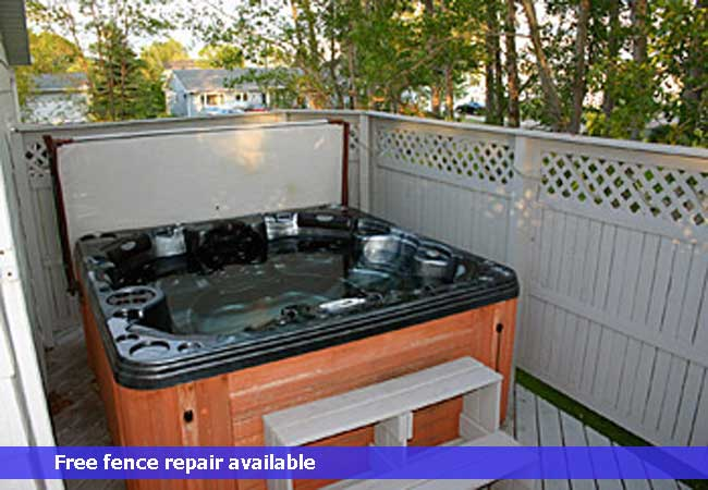 Vinyl lattice top privacy hot tub enclosure